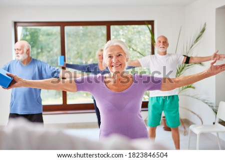 Senior group does aerobics for fitness and health in the gym Photo stock ©