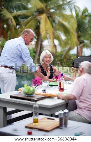 Senior group having a barbecue