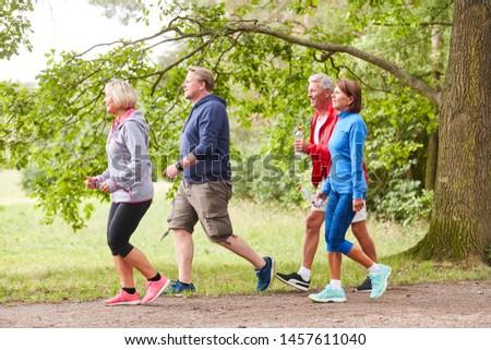 Senior group walking together as endurance training