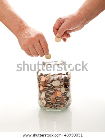 Senior hands collecting coins in a glass jar - saving for retirement concept, isolated