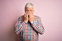 Senior handsome hoary man wearing casual colorful shirt over isolated pink background rubbing eyes for fatigue and headache, sleepy and tired expression. Vision problem