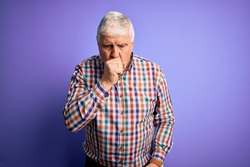 Senior handsome hoary man wearing casual colorful shirt over isolated purple background feeling unwell and coughing as symptom for cold or bronchitis. Health care concept.