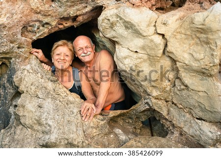 stock photo senior happy couple having fun at the entrance of kayangan cave in coron adventure travel in 385426099