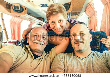 Senior happy couple with son taking selfie at bus trip in Laos - Adventure travel in south east asia - Concept of active elderly and love sharing moments with family - Vintage filtered look #736160068