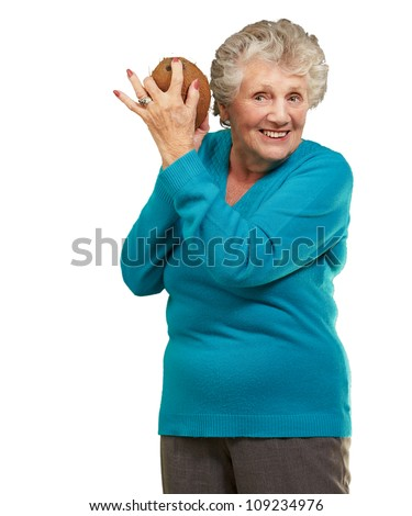 Senior happy woman holding coconut isolated on white background