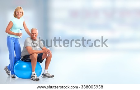 Senior healthy fitness couple. Over blue background Stock photo ©