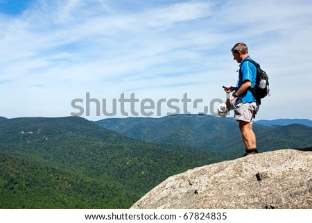 Senior hiker looks over valley in the Shenandoah on a climb of Old Rag