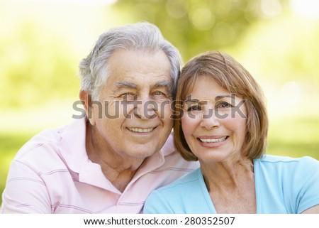Senior Hispanic Couple Relaxing In Park #280352507