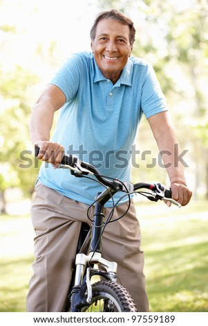 Senior Hispanic man riding bike