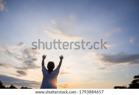 senior is rising hands  to the sky, morning sun or dawn warm light, new hope new life concept.  Photo stock ©