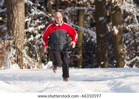 senior jogging in the snow