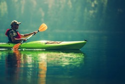 Senior Kayaker on the Lake. Kayak Paddling. Water Sport and Recreation.