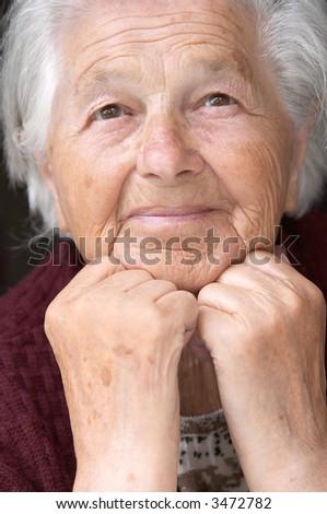 Senior lady looking ahead, portrait - stock photo