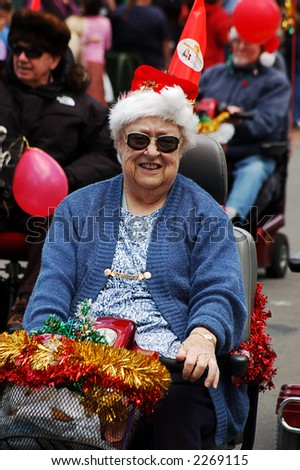 senior lady on mobility scooter in xmas parade