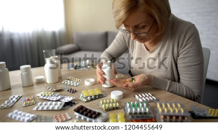 Senior lady taking too much pills, feeling unwell, heart problem self-medication