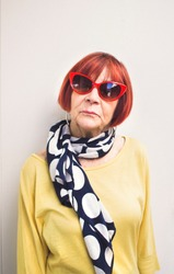Senior Lady with Red Cat-Eye Sunglasses