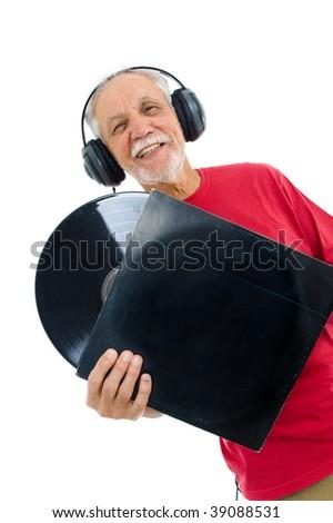 Senior listen music and hold a LP