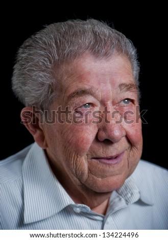 Senior looks smiling into the camera