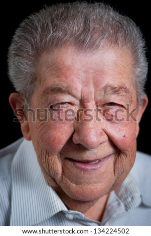 Senior looks smiling into the camera