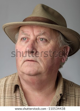 senior male close up portrait in hat