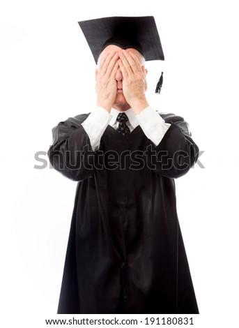 Senior male graduate hiding his face