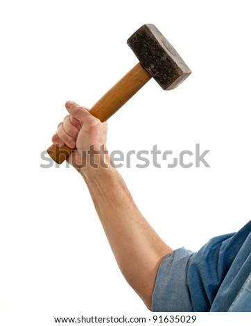 Senior male holding a large lump hammer isolated against white