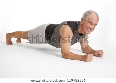 Senior male holds yoga pose