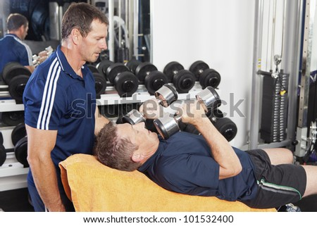 Senior male spotted by personal trainer