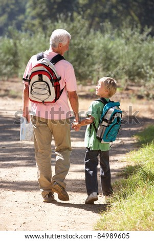 Senior man and grandson on country walk