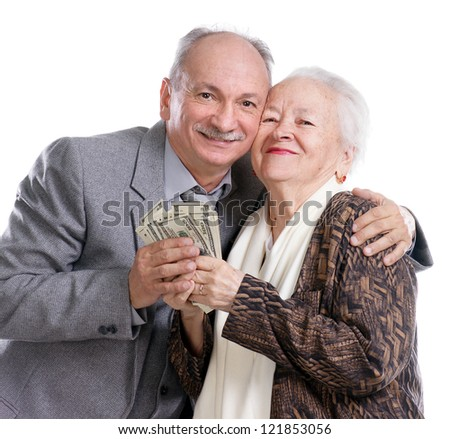 Senior man and old woman with money on white background - stock photo