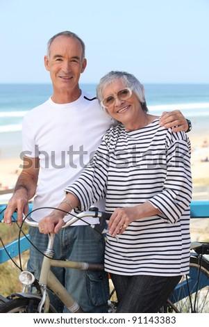 senior man and senior woman at the beach - stock photo