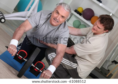 Senior man and sports trainer