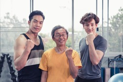 Senior man and young group people, Friends different ages in gym working out