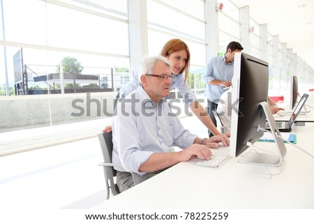 Senior man attending business training