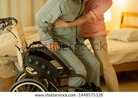 Senior man being cared by a female caregiver ストックフォト ©