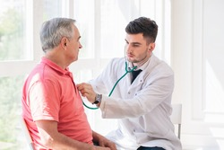 Senior man being examined by a doctor.