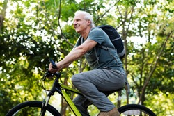 Senior man biking in the park