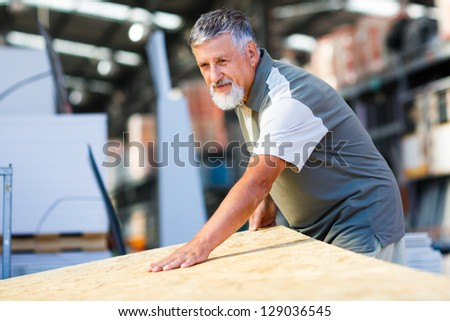 Senior man buying construction wood in a  DIY store #129036545