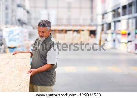 Senior man buying construction wood in a  DIY store #129036560