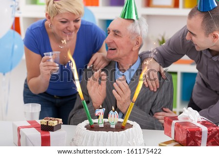 Senior man celebrating birthday with his family