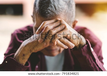 senior man covering his face with his hands.vintage tone #791834821