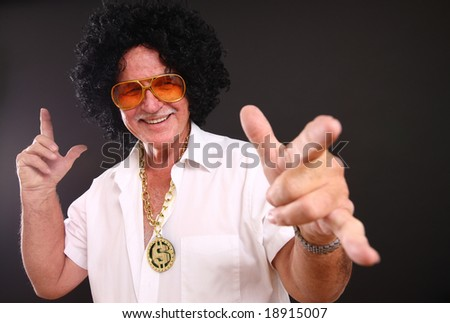Senior man dressed up in funny costume - stock photo