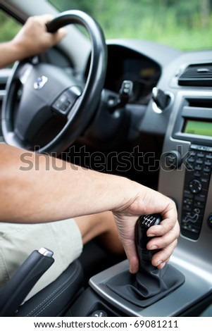 senior man driving a car (shallow DOF)