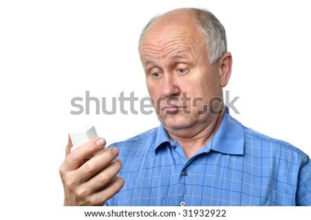 senior man examining something