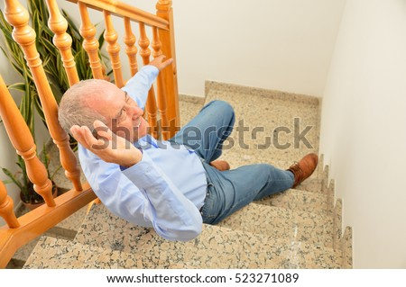 senior man falling down on stairs with hands up to try to catching the railing Stock photo ©