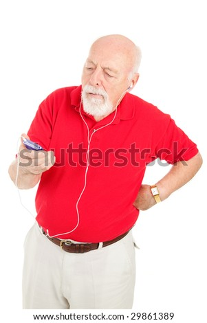 Senior man frustrated with his mp3 player.