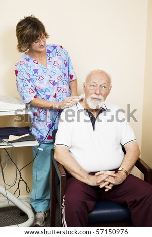 Senior man gets ultrasound therapy for his neck pain.