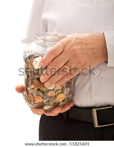 Senior man hands holding jar with coins closeup - retirement fund and savings concept