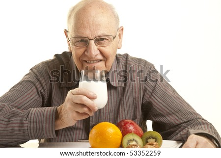 Senior man having a healthy breakfast isolated on white