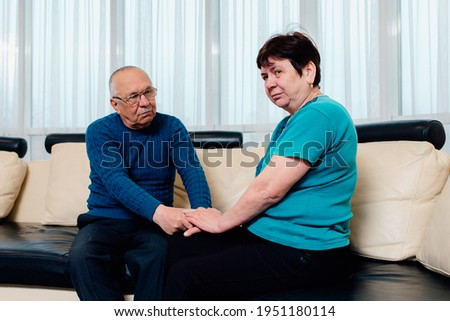Senior man having conflict with his wife in bedroom. Relationship problems. Senior husband giving support to crying mature wife, consoling unhappy woman with empathy and compassion Stock photo ©
